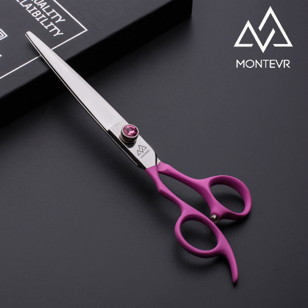 Fine quality dog grooming scissors in left hand